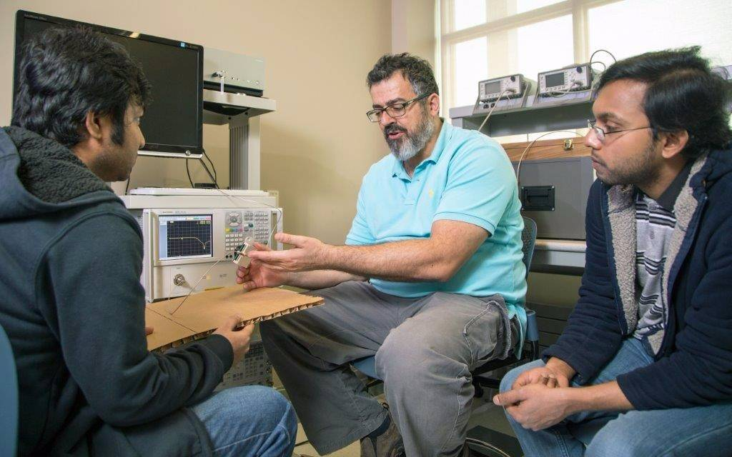 ECE Professor talking with Graduate students