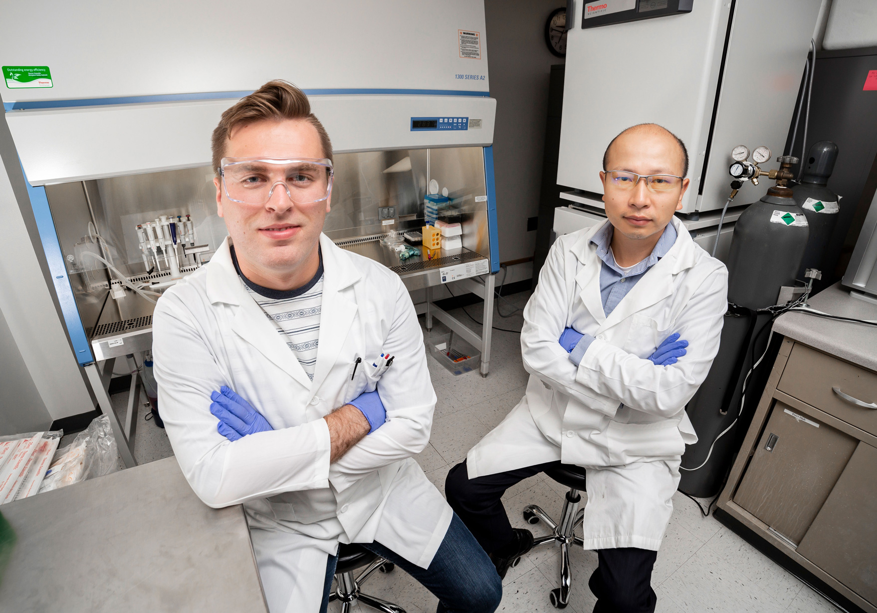Gregory Jensen and Dr. Yu Huang in the lab