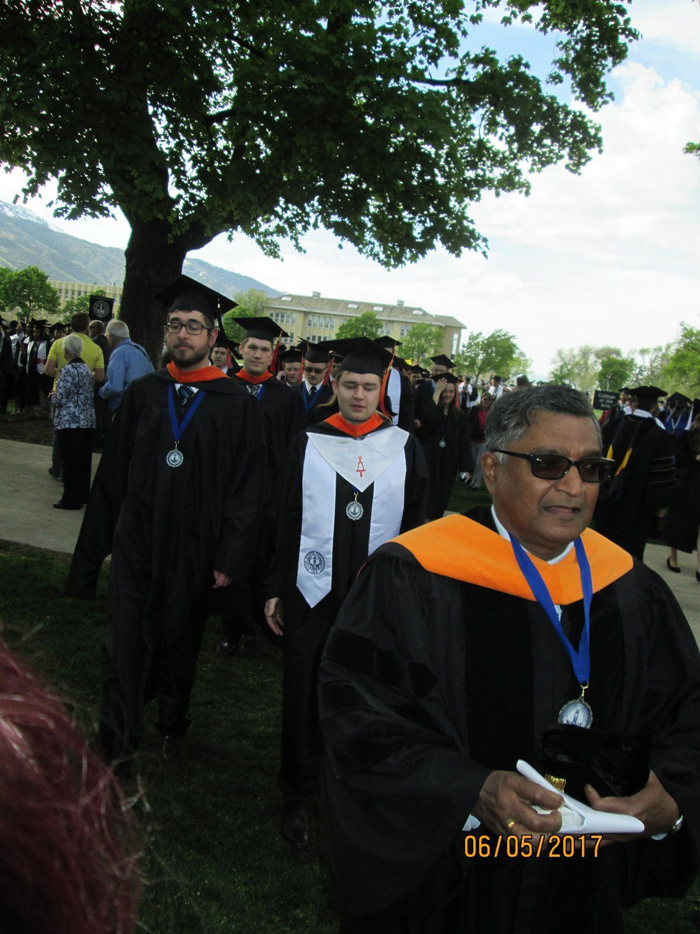 Jagath Kaluarachchi walking with professors