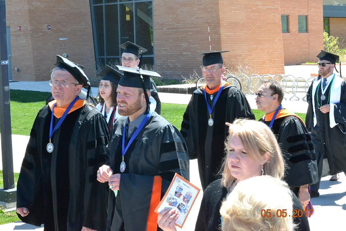 Professors walking down sidewalk