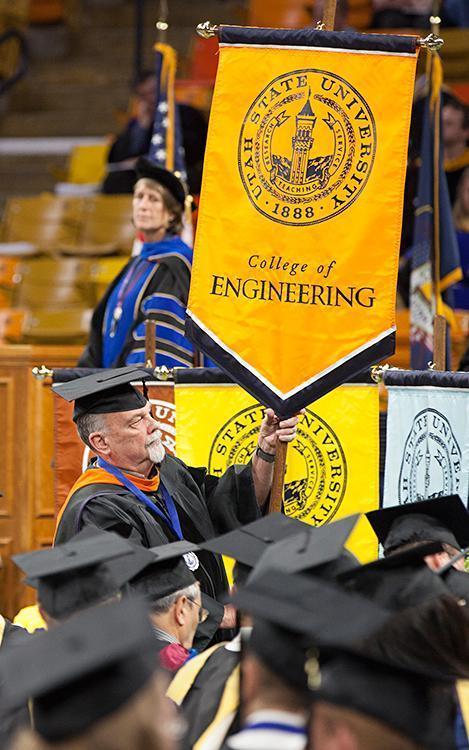 College of Engineering flag being held
