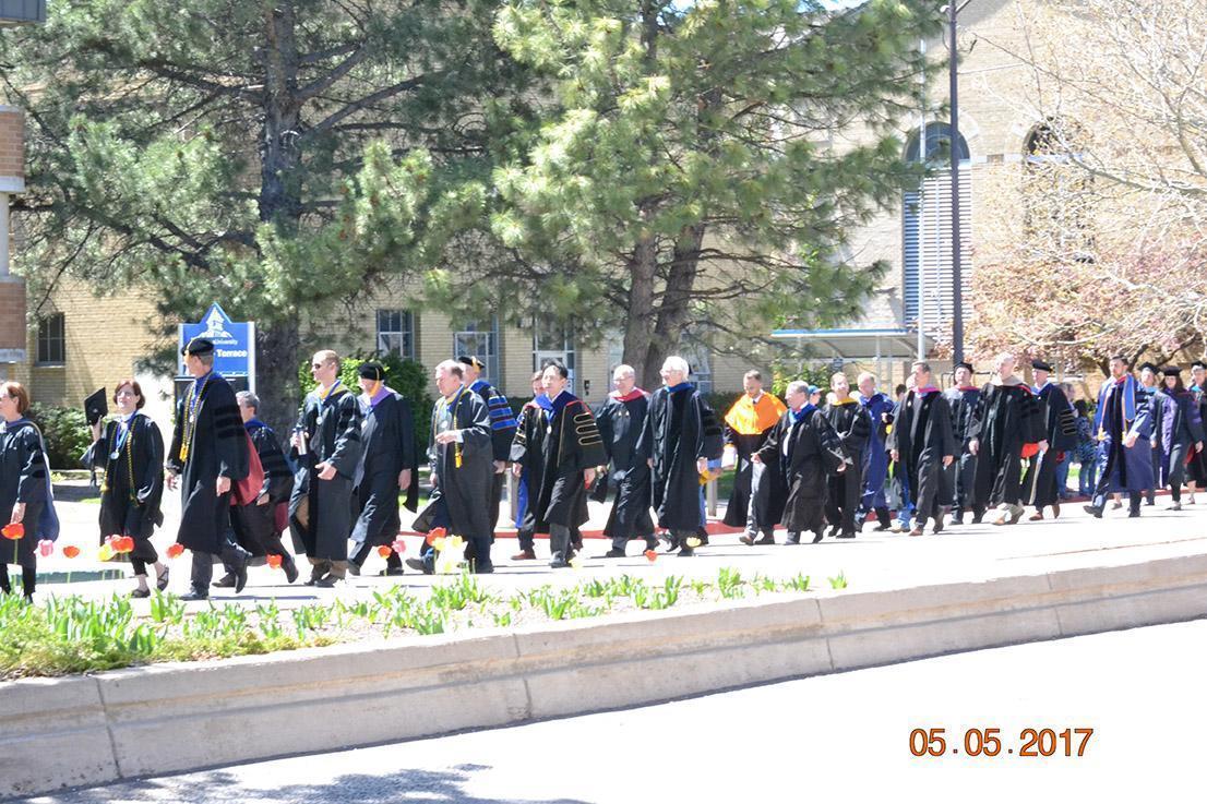 Graduates walking down road