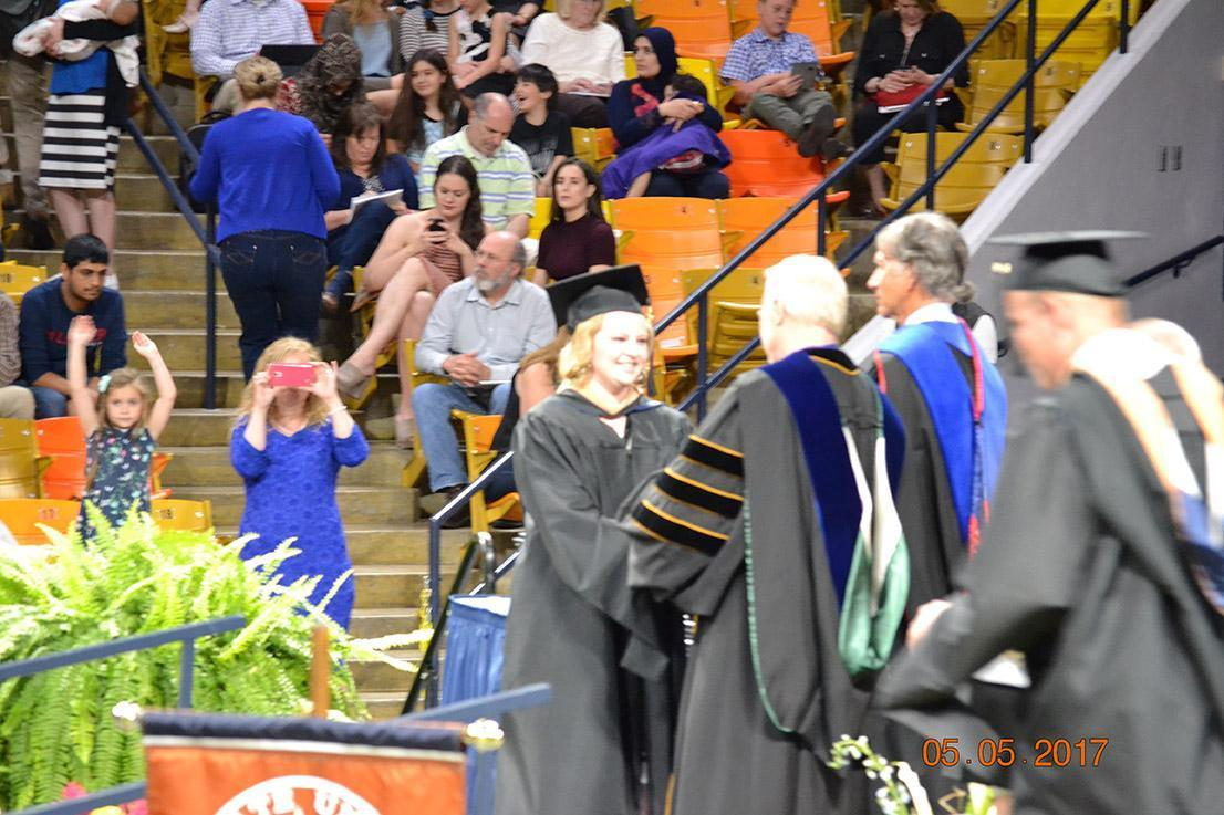 Graduate shaking professors hand