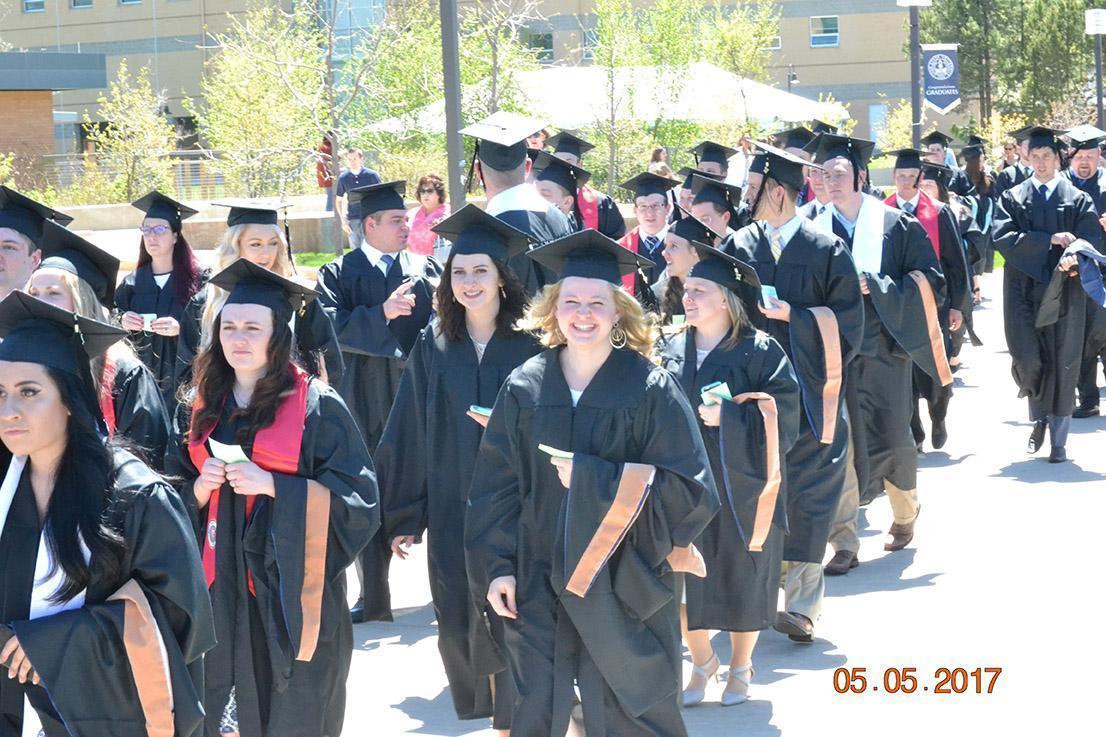 Graduates walking down the sidewalk