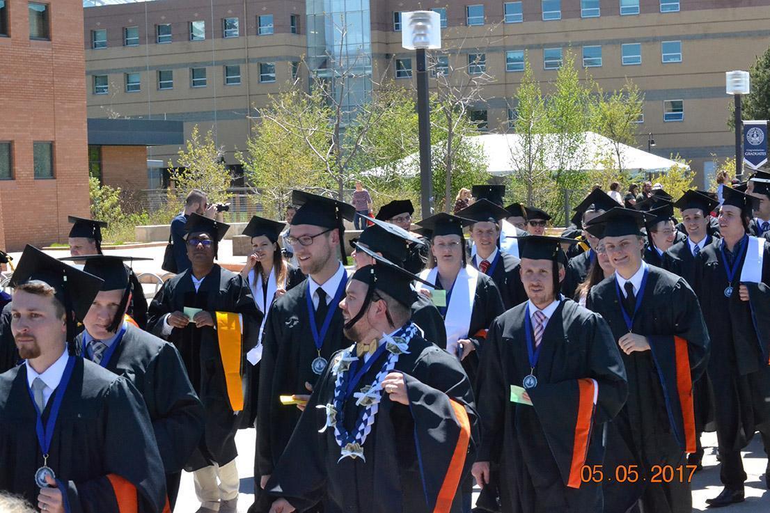 Graduates walking down roads