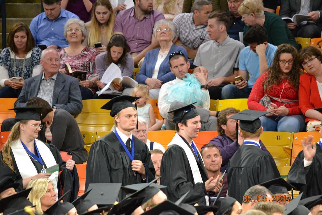 Graduates standing up