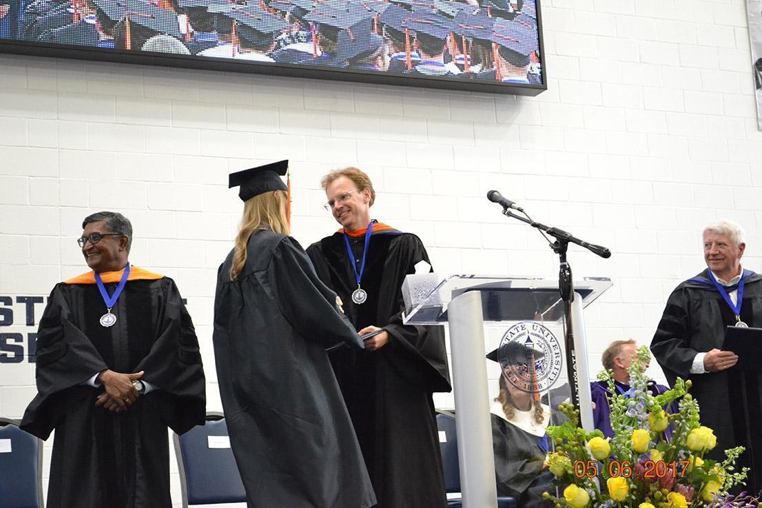 Graduates shaking professors hands