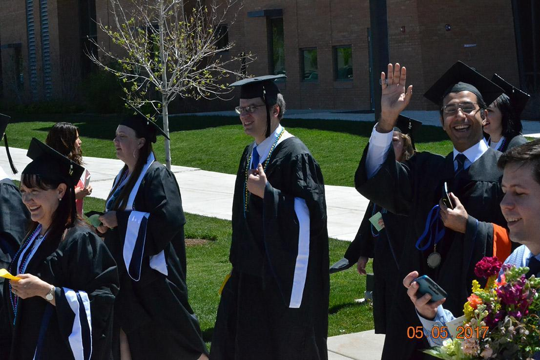 Graduates waving to someone